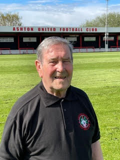 One of our adventurers, Ronny, at Ashton United Football Club in his Ashton United shirt