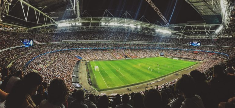 photo of wembley stadium taken from the crowd
